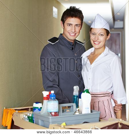 Friendliy service staff in hotel with bellboy and hotel maid