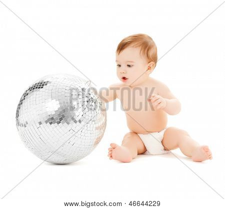 bright picture of happy child playing with disco ball