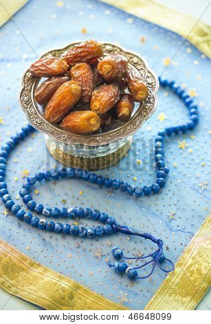 Arabic dates and rosary- top angle
