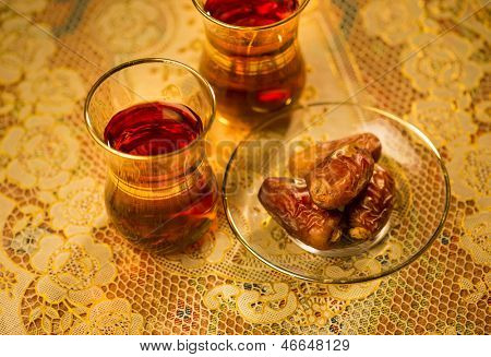 Dates and black tea