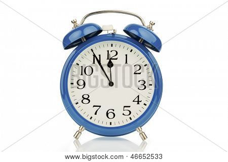 a blue alarm clock on a white background. five to twelve
