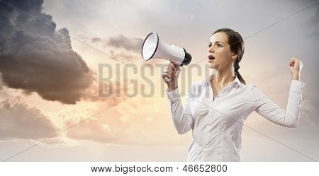 Businesswoman screaming in megaphone