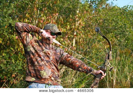 Bow Hunter Shooting