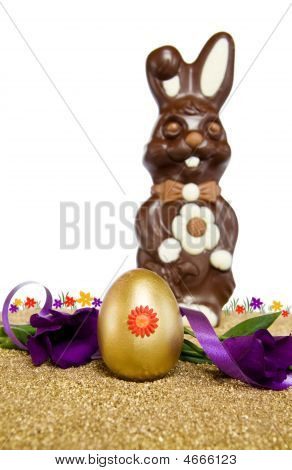 Easter Golden Egg And Chocolate Bunny Over White