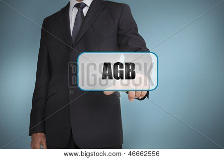 Businessman touching tag with agb written on it on blue background