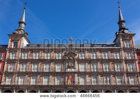 Architecture at Plaza Mayor in Madrid, Spain / Casa de la Panaderia / sunlight and blue sky