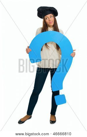 Contemplated Female Chef Holding Question Mark Sign Over White Background