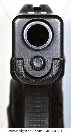 Looking Down Barrel Of Semi-automatic Handgun
