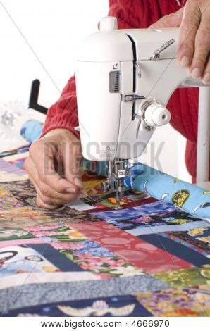 Quilter Working On Sewing Machine