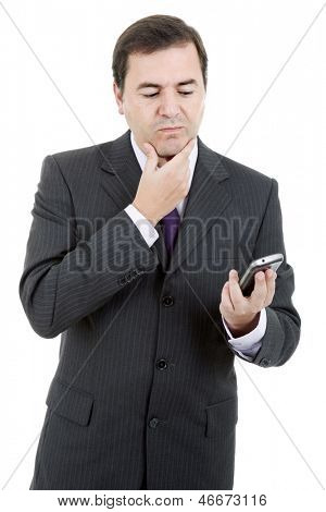 young business man looking to his phone, isolated