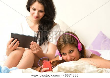 Best friends listening to music and reading in the afternoon