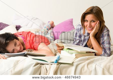 Young caucasian girls studying at home