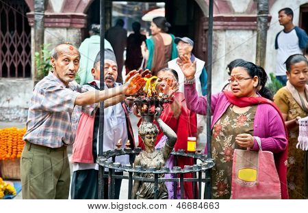 KATHMANDU,NEPAL-MAY 19:Devotees are purification by fire in Seto Machindranath or Jana Bahal Temple on May 19, 2013 in Kathmandu, Nepal. Jana Bahal Temple is one of the must visit temple in Kathmandu.