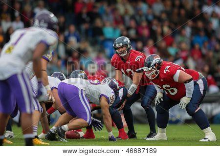 VADUZ, LIECHTENSTEIN - JULY 21 QB Marko Glavic (#13 Broncos) waits for the snap on July 21, 2012 in Vaduz, Liechtenstein.