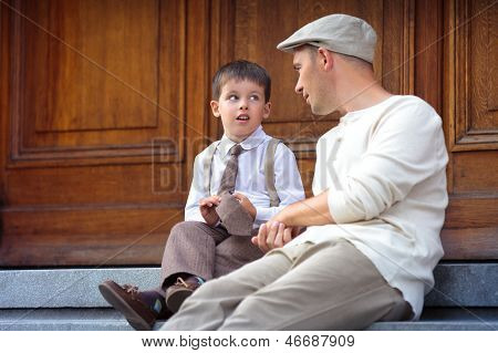 Young father and son outdoors in city