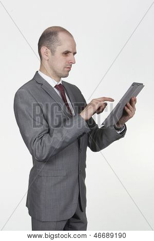Confident Businessman Using His Tablet-pc