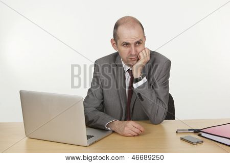 Thoughtful Businessman At His Desk