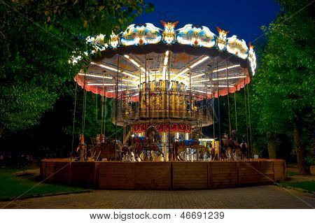 MOSCOW - MAY 25: Merry-go-round carousel at evening in Gorky Park on May 25, 2013 in Moscow. Gorky Park was completely renovated in the last few years and is becoming a very popular place for rest