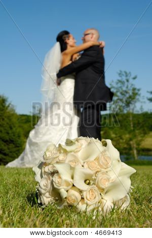 Wedding Bouquet And Couple