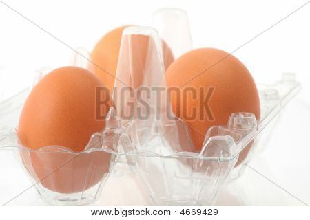 Plastic Box With Three Brown Eggs