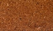 stock photo of coir  - Block of Coconut Husk Fiber Chips surface background - JPG