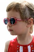 Portrait Of Little Girl With Sunglasses poster