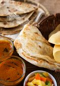 Indian meal, Chapati flatbread, roti canai, dal, curry, teh tarik or pulled tea, acar. Famous indian