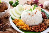stock photo of nasi  - Nasi lemak kukus traditional malaysian spicy rice dish - JPG