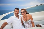 picture of hot couple  - Young couple on their yacht at sea - JPG