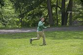 image of frisbee  - Young Man Playing Frisbee At The Park - JPG
