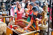 KATHMANDU,NEPAL-MAY 19:Devotees lights candles in Nara Devi Temple near to Jana Bahal Temple on May