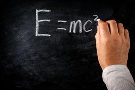 stock photo of einstein  - student writing on the chalkboard Einstein - JPG