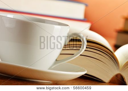 Composition With Cup Of Coffee And Books On The Table