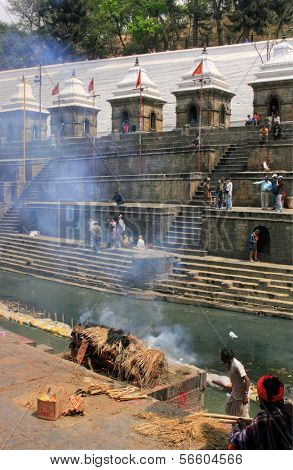 KATHMANDU, NEPAL - 27 MARCH 2010: Hindu cremation site and ceremony in Pashupatinath Ghat in Kathmandu, Nepal on 27th March 2010.