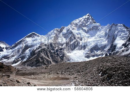 Nuptse mountain against blue sky. Nuptse (7891m) is a mountain in the Khumbu region of the Mahalangur Himal, in the Nepalese Himalayas. It lies two kilometres away of Mount Everest
