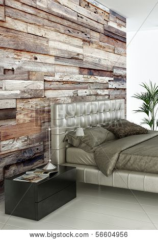 Modern double bed standing against wooden wall