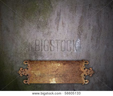 Old rust metal nameplate on a old wall