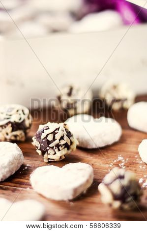 Chocolate almond candies and vanilla cookies