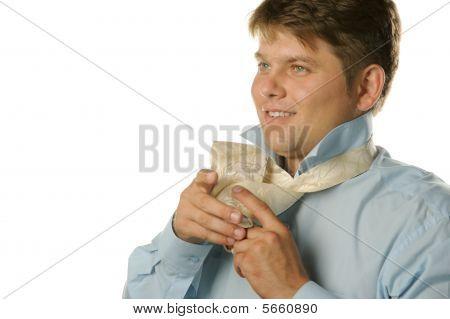 The Man Fastening Necktie
