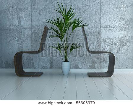 Dos sillas de pie de espaldas uno al otro con planta en el medio