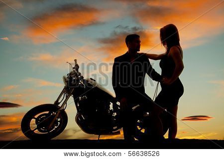 Silhouette Of Woman By Man On Motorcycle