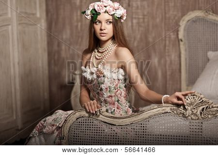 Luxury young smiling beauty woman in vintage dress in elegant interior.