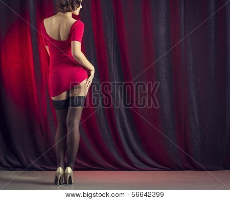 Sexy woman dancing on stage