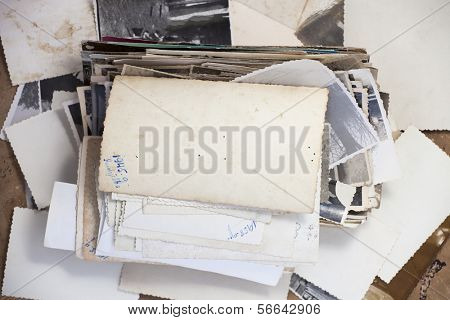 Stack of old photos with turned up photo for your image or copy.