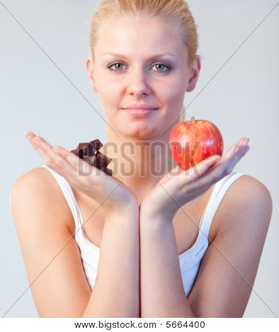 Beautiful Woman Holding Chocolate And Apple Focus On Woman