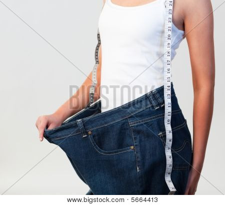Close-up Of Woman Wearing Big Jeans Focus On Woman