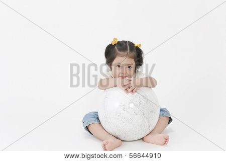 A terrestrial globe and girl