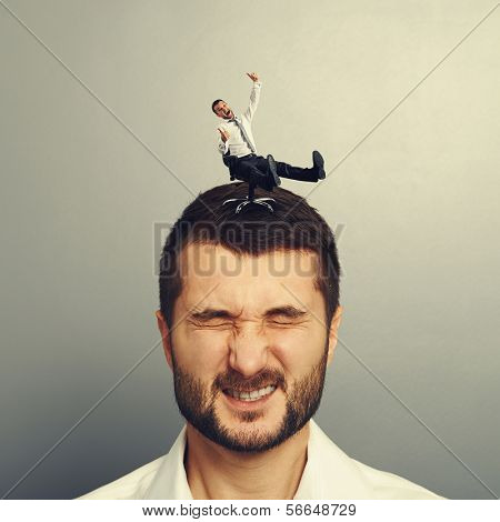 crazy man rolling on the head of another man