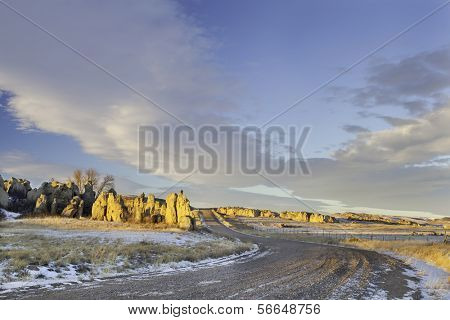 backcountry road over prairie in northern Colorado with Natural Fort geological landmark