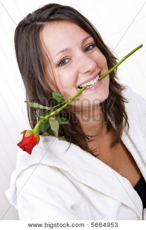 Woman Biting Rose